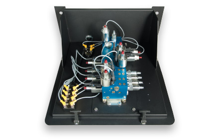 Modular manifold valve assembly used by snowplow trucks for snow and ice removal