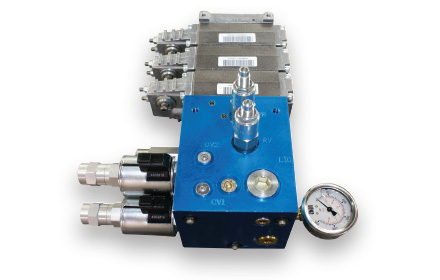Modular spool valve system used by snowplow trucks for snow and ice removal